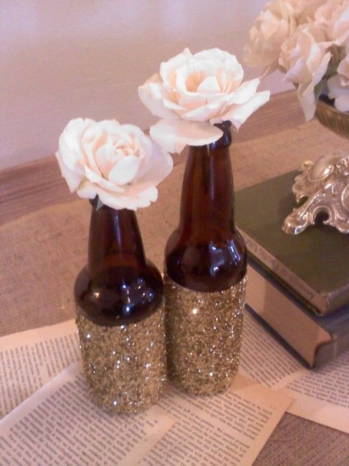 glitter beer bottles or wine bottles. add more flowers for wedding center
