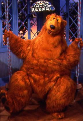 The brown bear in the blue housee !