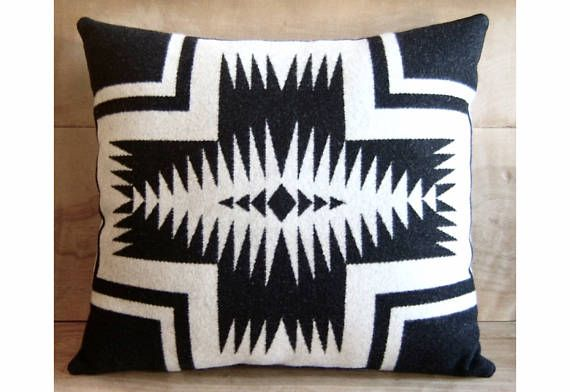 Handcrafted with Pendleton® fabric Black & White Native American design on front From Walking Rock blanket fabric Medium gray Pendleton wool blanket fabric on back Handfilled with an ultrasoft, high quality fiberfill Handsewn fully enclosed Finished size is 17x18.5  Same design / opposite colors: https://www.etsy.com/listing/111318010/pillow-pendleton-wool-fabric-black-white  Smaller matching pillows: https://www.etsy.com/listing/110641153...