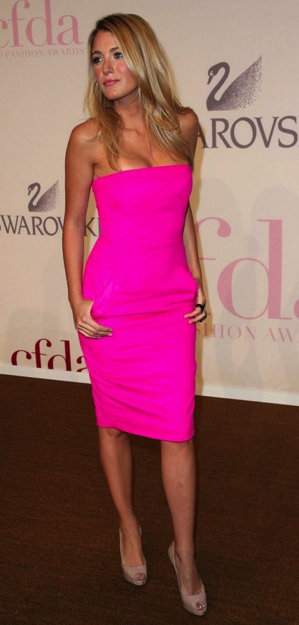 Blake Lively in a Strapless Fuchsia Dress with side Pockets and Nude Louboutins