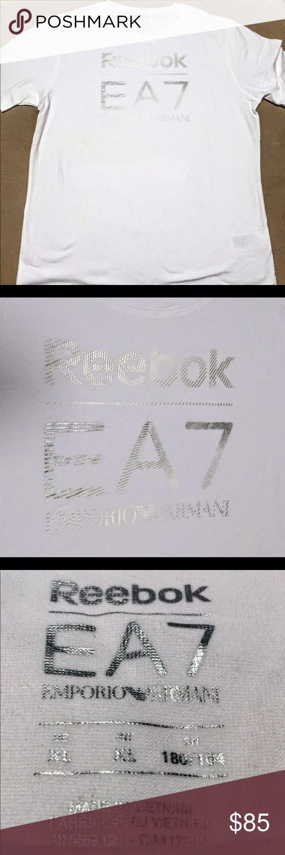 NWT $95 Armani x Reebok Collab Tee ~ XL Brand new, never worn! This tee is from a Collab collection between Armani (Ea7) & Reebok. Great quality T-shirt!! • Fits True to size • White Tee with Silver graphics Armani Shirts Tees - Short Sleeve