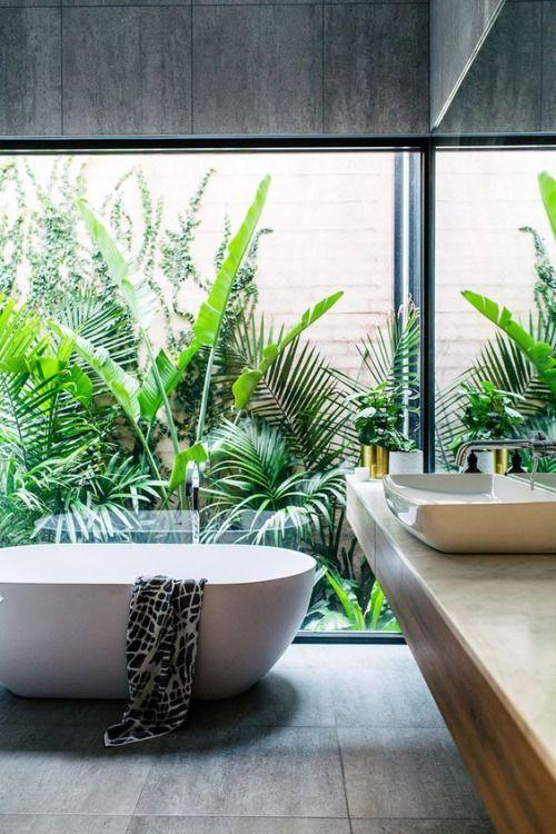 White bathtub and surrounding exterior Palm botanicals - SABON HOME
