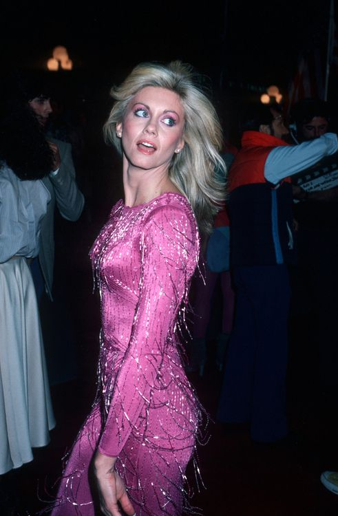 Olivia Newton John, 1980, love this pink dress she is wearing.  So, of course, I put it here.