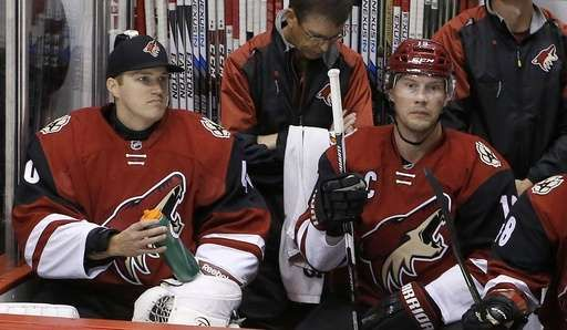 Emergency goalie: The most unique 1‐day job in sports:      FILE ‐ In this Feb. 15, 2016, file photo, Arizona Coyotes backup goalie Nathan Schoenfeld, left, signed to the team only hours prior to the game due to an injury to goalie Anders Lindback, sits next to Shane Doan during the second period of an NHL hockey game, in Glendale, Ariz. Hockey is the only professional sport where someone can go from being a fan to suiting up in the NHL.