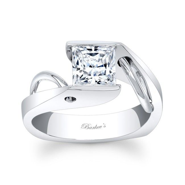 Princess Cut Solitaire Ring - 7831LW - A bold contemporary twist on a vintage bypass ring this solitaire engagement ring is a dazzler.  The channel set princess cut diamond is squarely captured by the shanks ridges. Featuring a wire accent trim arching up the sides and poking through the shank to the outside wall for a stunning unique look.    Also available in yellow gold, two tone, 18k and Platinum.