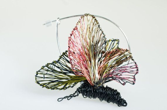 #Butterflybroochpin #Blackbutterfly #Unusualjewelry #Butterfly #Wirejewelry #Wearableart #jewelry# Sculpturaljewelry #Statementjewelry #gift This is a handmade black butterfly brooch pin unusual jewelry made of colored copper and silver wire.The height of the wire butterfly ,wearable art sculptural jewelry is 3.5cm (1.38in) and the width (body with wings) is 2.8cm (1.1in).The pin of the statement jewelry gift is silver.