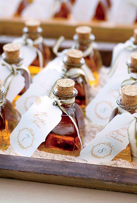 Mini rum bottles escort cards for a destination wedding
