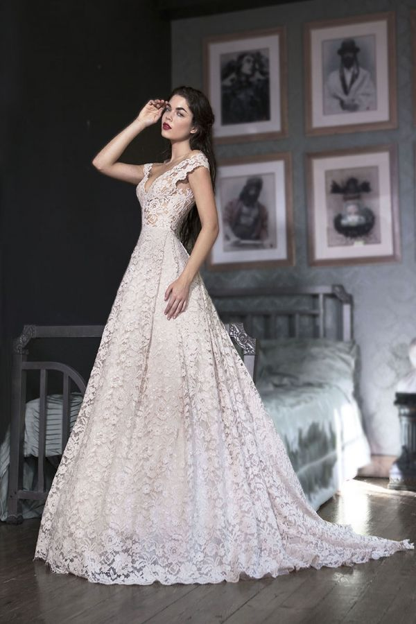 Dusty Pink Princess line gown with a sweetheart neckline and an open back