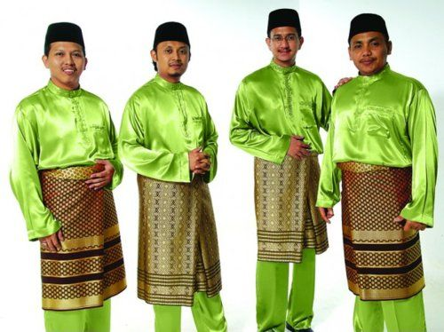 Members of the Malaysian singing group Hijjaz wear traditional Malay dress for  men: a baju melayu tunic and songket cloth around the waist.