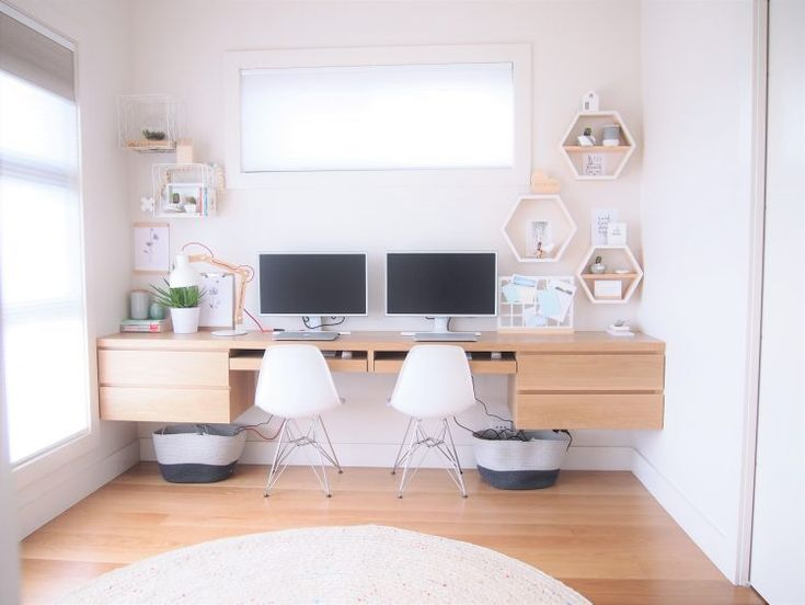 Custom built floating desk made from solid timber. Stylish light and airy office with hexagon wall shelves. Contemporary Australian design home.