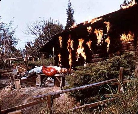 The Burning Settler's Cabin is still visible from Frontierland's rides, but its story has changed drastically over the years. The first Disneyland guests saw a burning cabin with a settler sprawled out front with an arrow in his chest. Visitors were told that an unfriendly Indian had shot the settler in the back and then torched his cabin. In the 1970s, this portrayal of Native Americans was recognized as offensive and blame for the settler's misfortune shifted to river pirates.