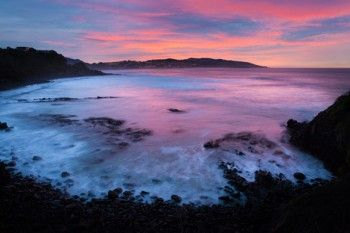 Second Beach glows pink in the pre-dawn light at St Clair, Dunedin. Photo from Box of Light New Zealand - all prints available for purchase.