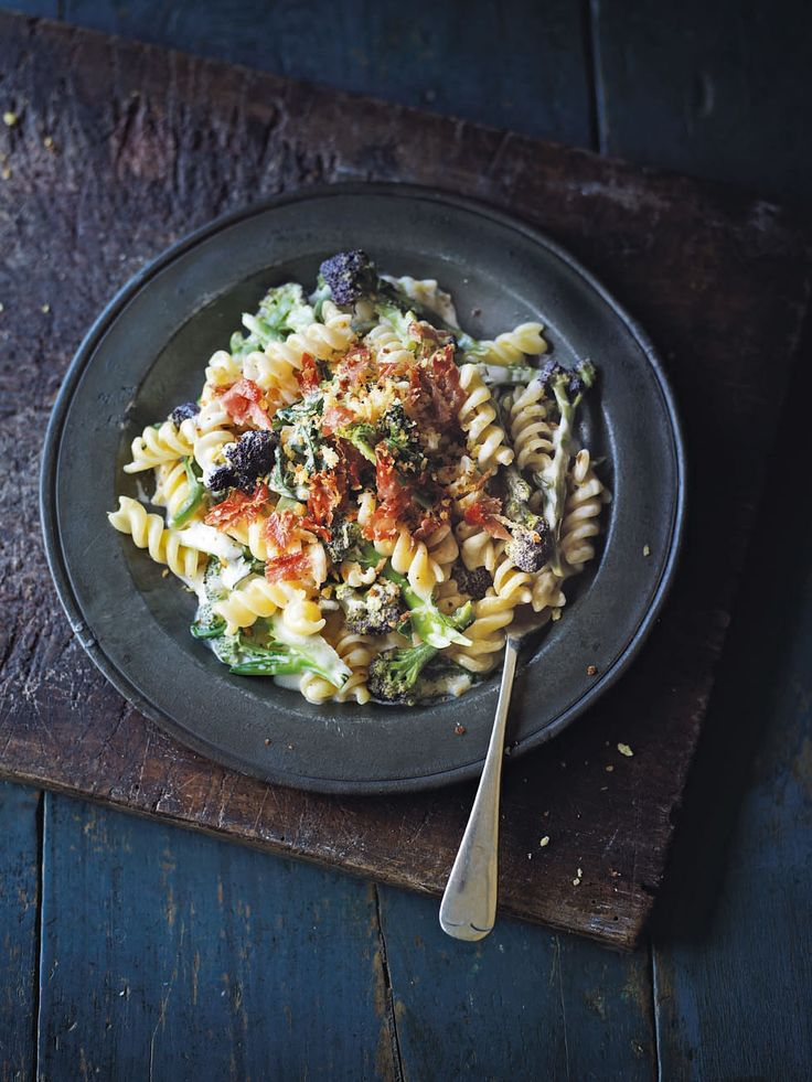 Fusilli pasta is topped with purple sprouting broccoli, parma ham and breadcrumbs in this quick and easy supper.