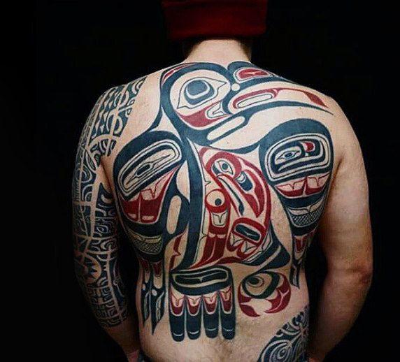Guy With Huge Raven Haida Tattoo On Back