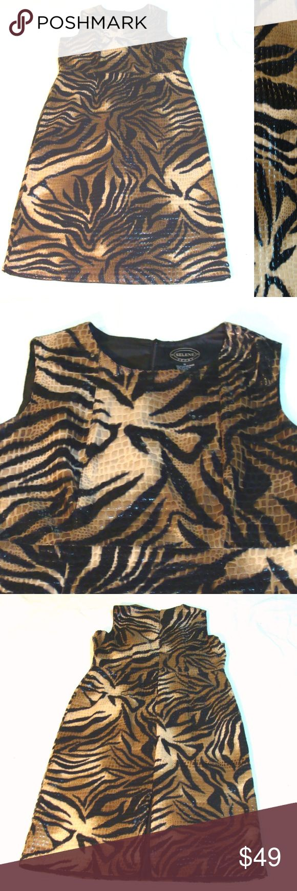 """Vintage tiger stripe pvc dress-safari dance club Funky and fun! Oh so unique vintage pvc tiger stripe long dress. Soft material , not rubbery . Ladies size 1x . Approx 51"""" from shoulder to bottom and approx 23"""" across when laid flat. Zip up , back slit . Lined .  By Selene Sport. L154 Dresses"""