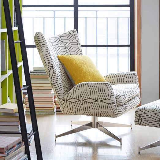 Our Hemming Swivel Armchair takes inspiration from the streamlined style of vintage Danish designs. We gave it a high back, winged sides and a deep, low seat, for a chair that's as comfortable as it is striking.