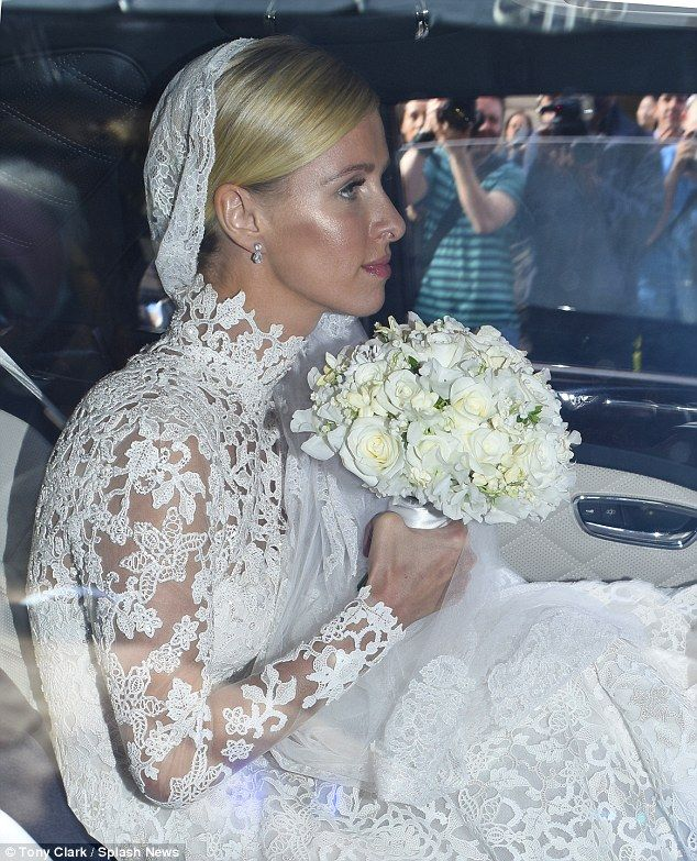 Childhood dream: Nicky, who wore her blond hair pulled back to showcase her dramatic veil,...