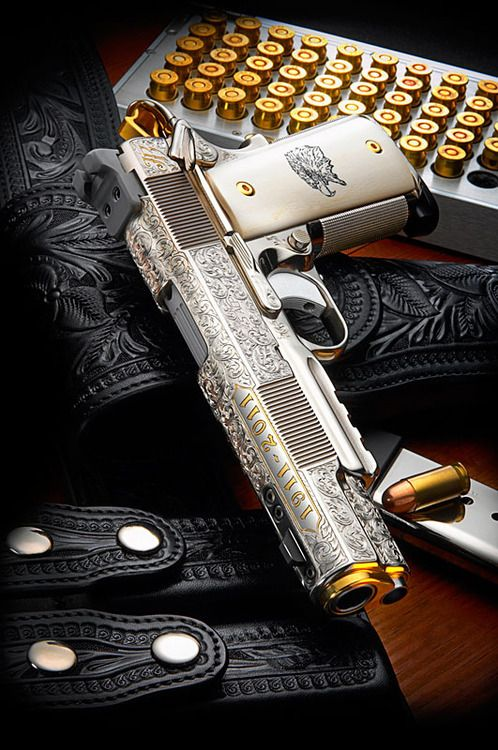 D Custom Centennial 1911 PistolThis Centennial 1911 .45 auto was completed to commemorate the 100th year of John Browning's 1911 design (2011). The pistol was hand engraved, and inlayed with gold and silver, and fitted with scrimshawed legal ivory stocks