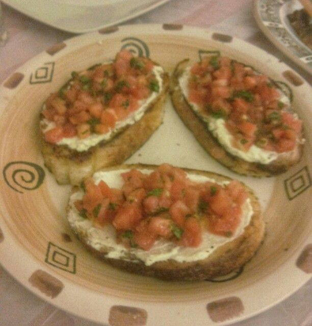 Bruchetta with a lebanese twist ... fetta cheese topped with tomato and mint leaves