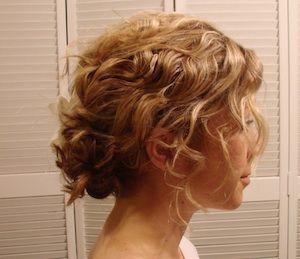 short curly tendrils, hair pinned back