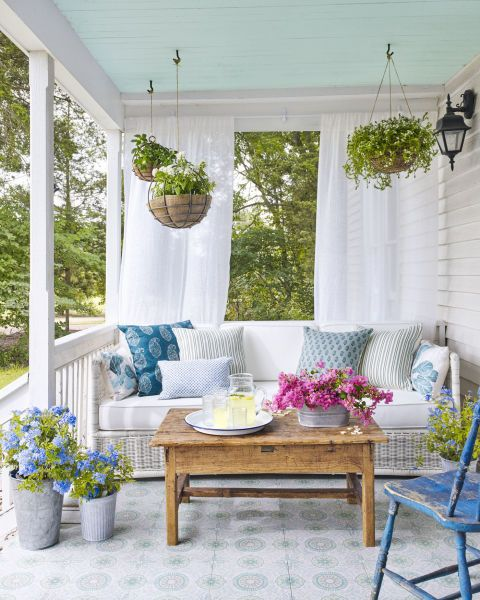 "Hang plants from the ceiling as opposed to sticking to the perimeter. On this Andrew Howard-designed porch at The Prairie by Rachel Ashwell in Round Top, TX, a perfect shade of haint blue (Yarmouth Blue by Benjamin Moore) sets a ""Good Times Only"" vibe."