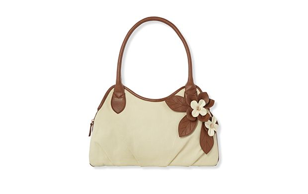 "Shoulder Bag with Corsage. ""The appliqué flower detail on this shoulder bag makes it extra special."""