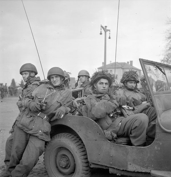 Personnel of the 1st Canadian Parachute Battalion, Greven, Germany, 4 April 1945. Photographer: Richer, Charles H. Location: Greven, Germany: Description: b3uz (L-R): Privates A.L. Dyck, R. Smith, R. Parfait, W. Hillhouse, L.A. Hopkins, Major R.C. Hilborn, Private D.R. Yeomans Subject: MILITARY - UNITS - ARMY - 1ST CANADIAN PARACHUTE BATTALION.@MILITARY - OPERATIONS - LAND - 1945/04/04.@Hilborn, R.C.@Hillhouse, W.@Hopkins, L.A.@Army. Date: April 4, 1945. MIKAN Number: 3405882 Item Number…