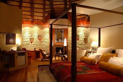 Mountain Lodge luxury suite with fireplace, underfloor heating and a private deck #Lesotho #Malibalodge #Malibamountainlodge