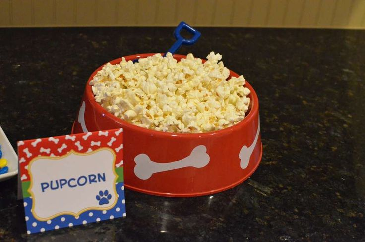 Pupcorn snacks at a Doggie birthday party!  See more party planning ideas at CatchMyParty.com!