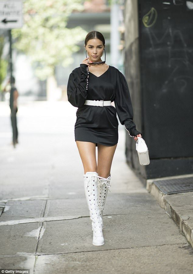 00bc12bacc6 Fierce  Olivia Culpo looked futuristic in this black mini dress with tall  boots in NYC Wed.