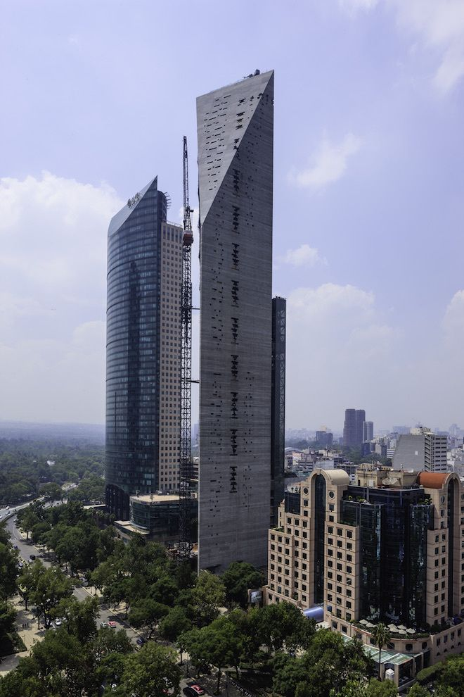 An 800-foot-tall triangular building called Torre Reforma in Mexico City will become Latin America's tallest exposed-concrete structure. To allow the walls to bend instead of break during an earthquake, the facade has irregularly spaced gaps to accommodate the flexion