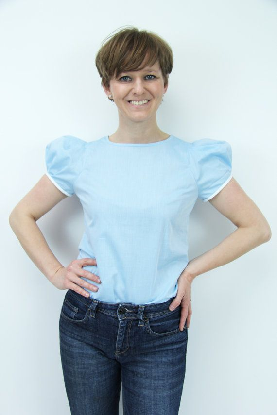 One of those Must Have items! Puff sleeves blue shirt! This simple cut short sleeve women blouse is made of beautiful sky blue cotton. Feminine and