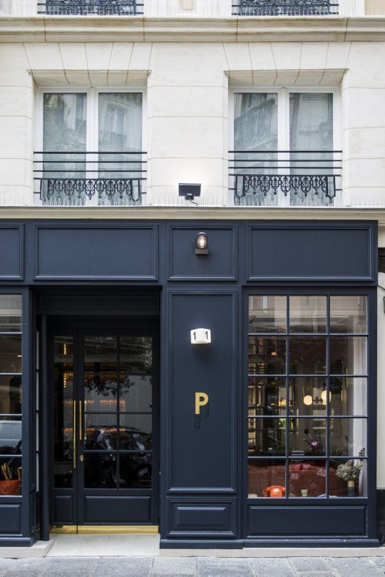 Inside the Hotel Panache, Paris: The hotel's exterior is an asset to the neighborhood with rich navy and gold hinting at the colour scheme inside.