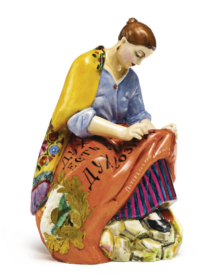 A woman worker sewing a banner, State Porcelain Manufactory, Petrograd, 1921 | lot | Sotheby's