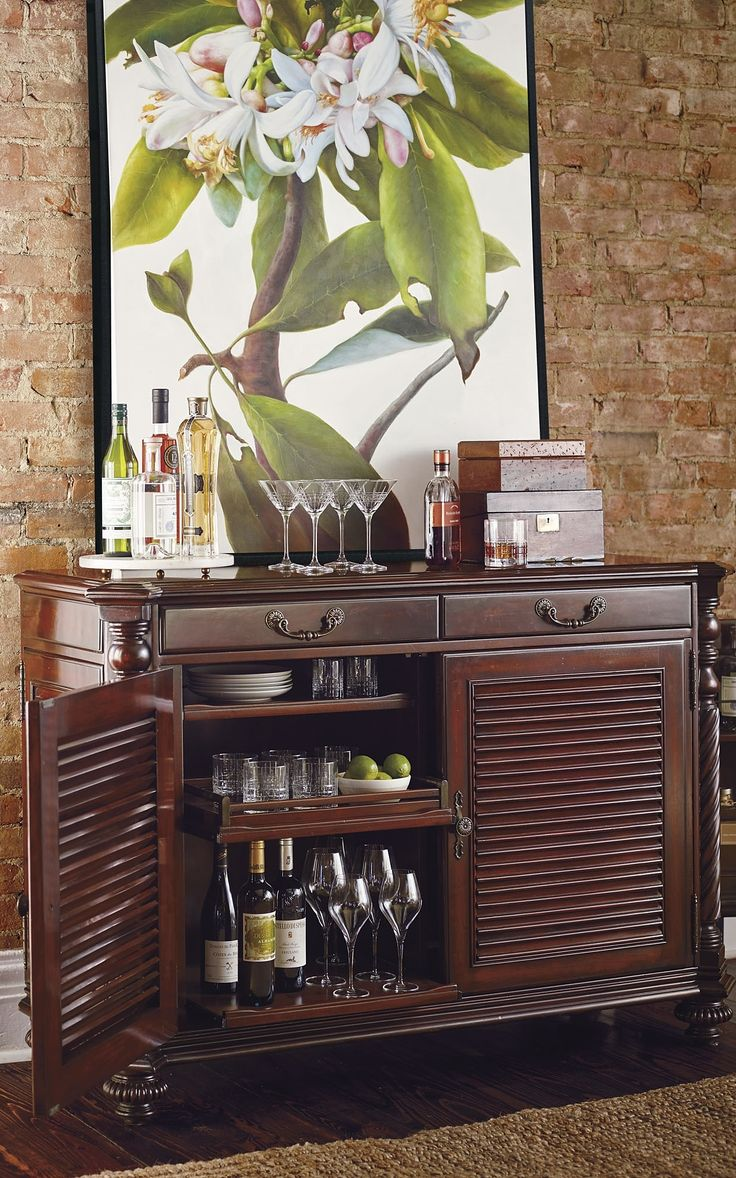 An heirloom piece that could anchor any room, our exclusive Double Forsyth Bar Cabinet is richly finished with British Colonial details and thoughtfully outfitted for multifunctional use.