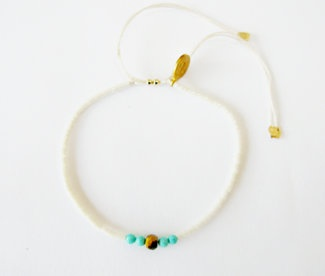 Limestone glass bead bracelet: Limestone glass beaded bracelet with Turquoise bead and tiger eye stone detail on 100% silk thread.  Size adjustable, 14k gold filled finishes.  $30
