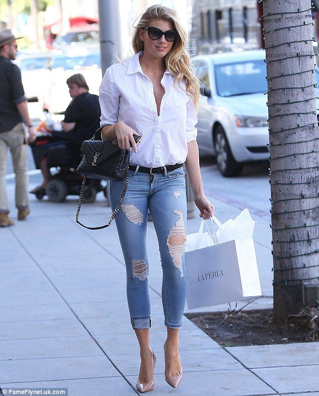 Model walk: Charlotte McKinney turned heads, wearing skintight ripped jeans while out shop...