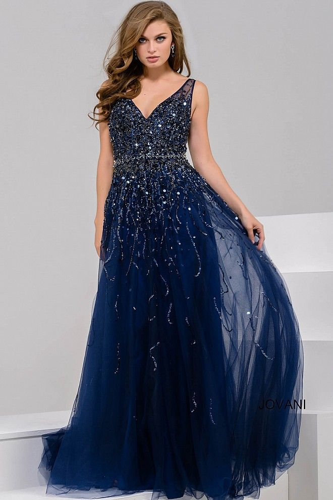 Navy fully beaded elegant sleeveless and v neck A line prom dress with embellished waistline and tulle skirt available in aqua, red and white in large sizes.