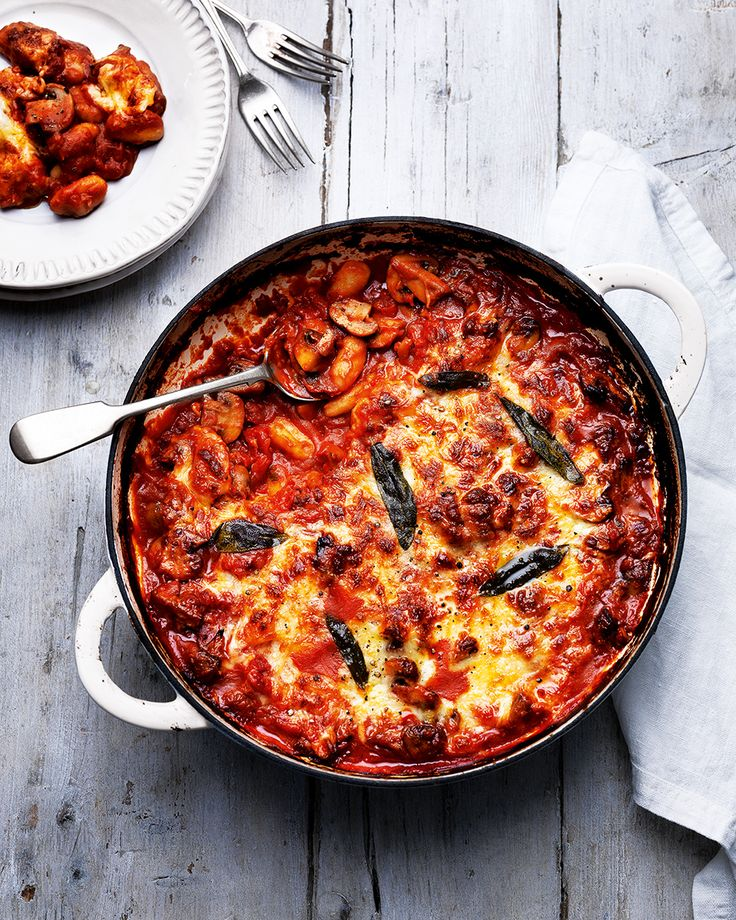 Gnocchi is the ultimate midweek go-to when it comes to quick, comforting meals. We've baked it with mushrooms, cheese and tomato sauce to make this ve