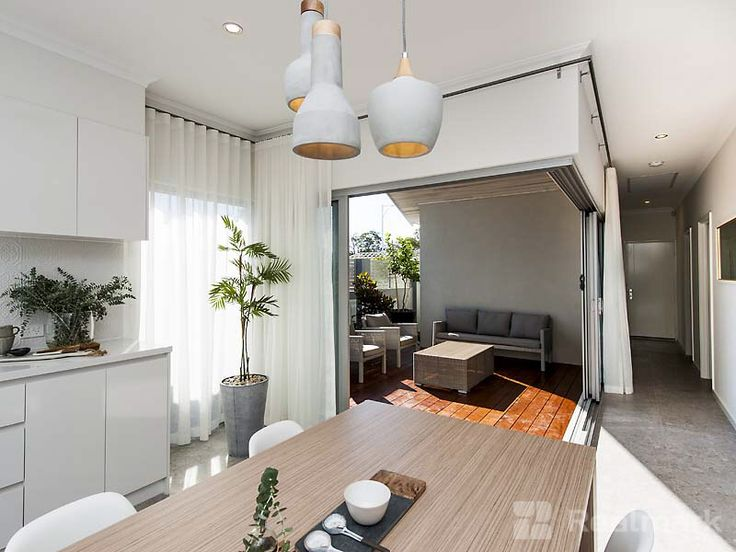Concrete pendant lights over custom designed built in dining table. Interiors by Colour Cube Interiors, Perth WA.