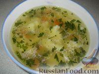 Фото к рецепту: Куриный суп с клецками из манки