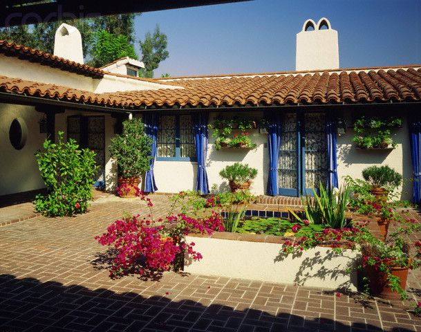Spanish Style Ranch Homes With Courtyards Small Lily Pad Covered Pond In Brick Courtyard Of