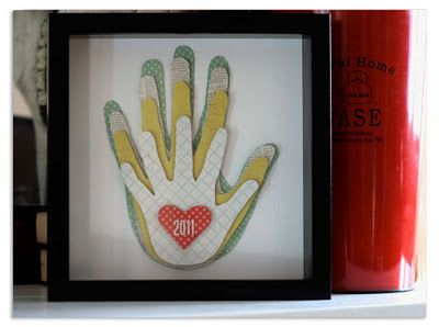 Family Hand Print Frame. What a great craft and memory. I like how this version used different fabric/craft paper for each hand and then the heart that notes the year.