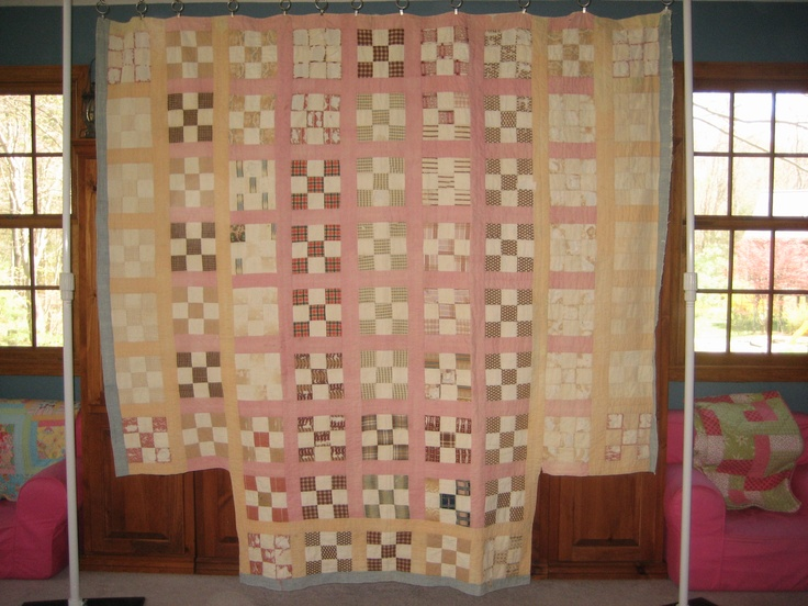 """This is an antique quilt from my family farm, @1850. It is @83""""x81"""", and is cut out for a four poster bed. The pattern is Nine Patches, in rows with sashing. It is not in good condition at all, but I am honored to have something that was made by someone in my family, so many generations ago."""
