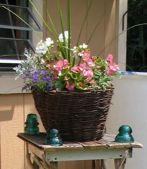i love using baskets for outdoor potted plants. its natural looking and you can