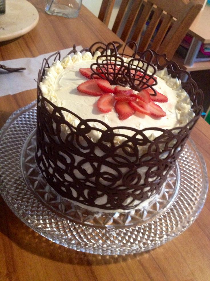 "Made by me! Strawberries & Cream birthday cake with dark chocolate. It was a huge hit! I found a tutorial for the ""chocolate cage"" here: http://doughmesstic.com/2013/03/01/how-to-chocolate-cage-tutorial/"