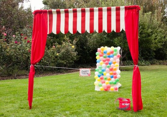 "DIY carnival booths: ""Create easy booths with a pvc frame secured in place by re-bar stakes. Add a simple striped valance and red side curtains for a perfect, kid-size booth. These carnival booths can also be stored and used again for other parties, family reunions, church activities or lemonade stands.""  {One Charming Party...see post for assembly instructions and free carnival printables}"