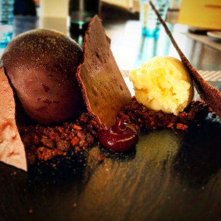 Traveller photo by V.V Dennis, Chocolate sphere, cocoa nib, crème fraîche sorbet,meringue slates, blackcurrant gel