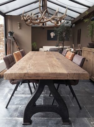 Industrial design table with a 8cm reclaimed oak top & old cast iron legs