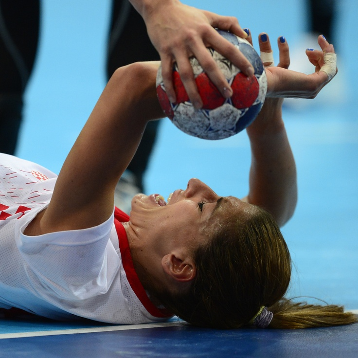 Croatia's rightback Andrea Penezic reacts after a fall during the women's quarter-final handball match Spain vs Croatia for the London 2012 Olympics Games on August 7, 2012 at the Copper Box hall in London.